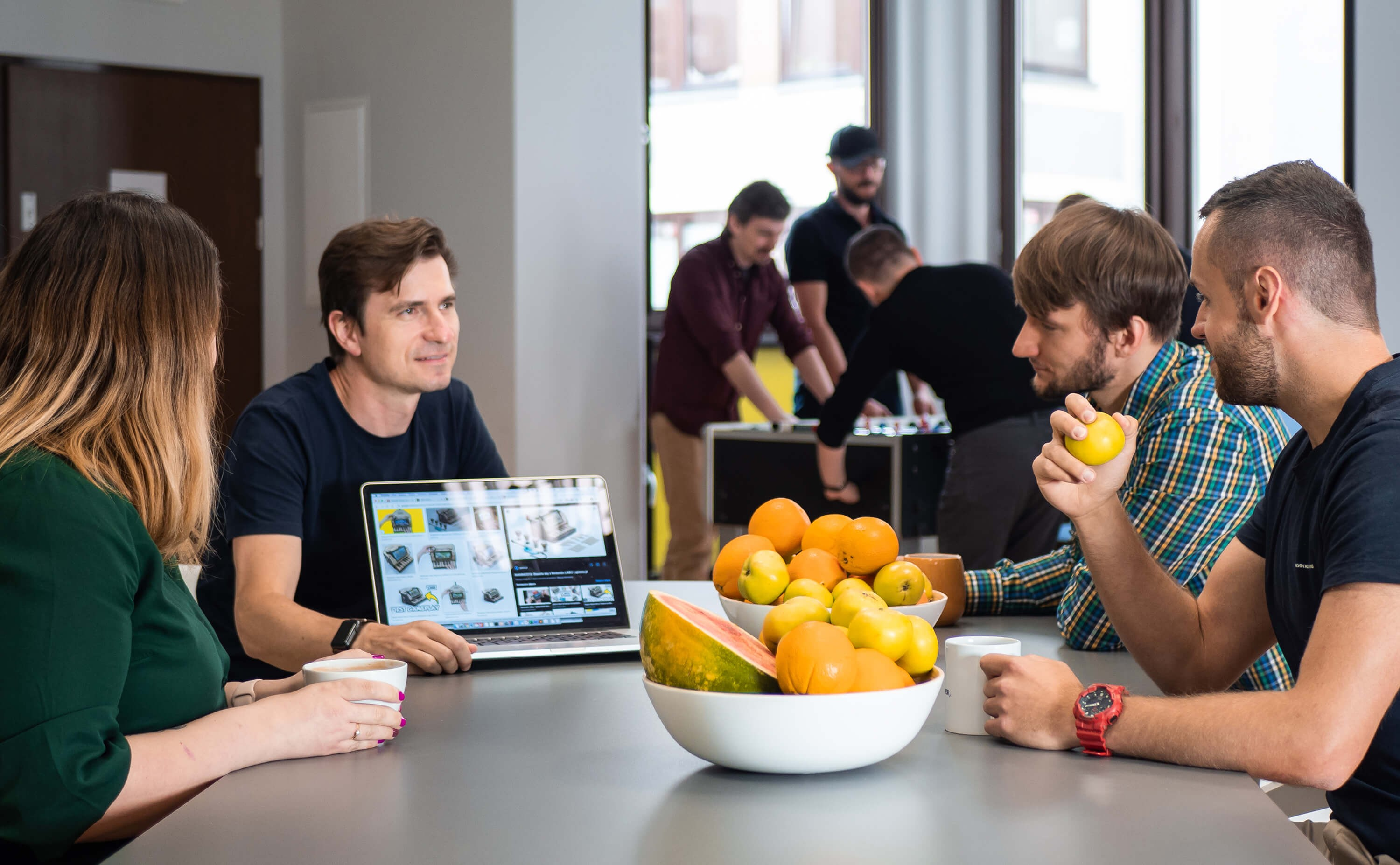 A photo of software developers discussing